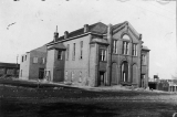 Ward Hall being torn down. Built 1897 for the opening of BNS