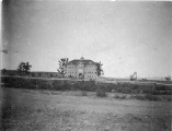 Distant view of Old Main; a picture of the first building on the school campus