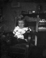 Magic lantern slide of a child in a chair