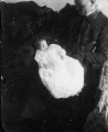 Print made from magic lantern slide [image of a man holding an infant]