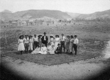 Class of 1909 on a patch of grass