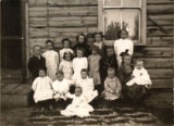 Brasher children in front of their home