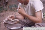 Vernon Condie eating breakfast of rattlesnake
