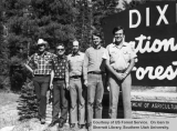 Rangers and Supervisor John V. Lupis by a Dixie National Forest sign