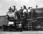 Transportation, group standing on engine