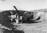 A 30 ton Euclid hauling from 80-D in road cut.