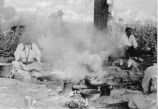Paiute women cooking