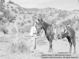 Unidentified woman with horse