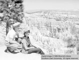 Unidentified man and woman overlooking canyon