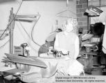Unidentified women ironing costumes for play