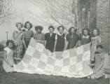 Young girls with quilt