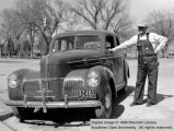 Emil L. Roundy beside his automobile; Cedar City, Iron County, Utah