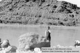 Joel Roundy at the rock where his father, Lorenzo Roundy, drowned; Kanab, Kane County, Utah