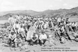 Men building wall around graves at Mountain Meadows; Washington County, Utah