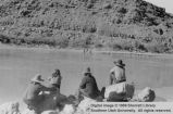 River scene with four men in foreground; Lees Ferry, Arizona