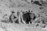 Six men and blanket; Lees Ferry, Arizona
