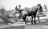 Couple in wagon; Cameron, Arizona