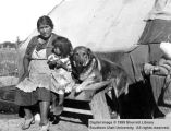 Woman, girl, and dog; Cedar City, Iron County, Utah