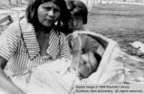 Wanda Frank with baby and girl; Cedar City, Iron County, Utah