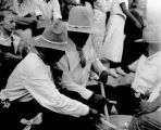 Paiute musicians making music with notched sticks and upturned washtub; Cedar City, Iron County,...