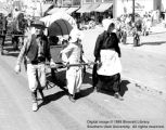 Handcart Pioneers float; Utah Centennial Parade; Cedar City, Iron County, Utah