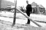Man standing near street; Cedar City, Iron County, Utah