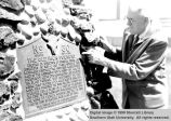 William R. Palmer reading the inscription on Iron Mission Pioneers Monument; Cedar City, Iron...