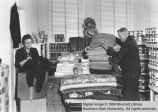 William R. Palmer and Bernice Linford working in storehouse; Cedar City, Iron County, Utah