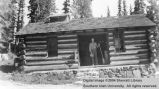 Utah Parks employee in front of Cedar Breaks Cabin