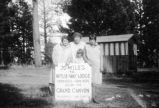 Woman and three children advertise Wylie Lodge