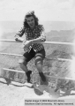 Woman sitting on lookout fence