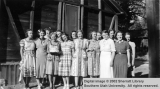 Cabin maids, with birthday cake